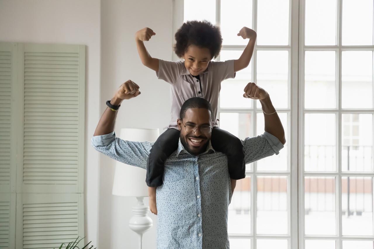 beneficios da vitamina a pai e filho sorrindo